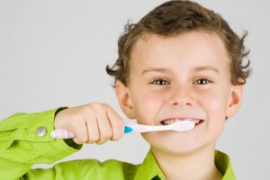 brushing teeth with homemade toothpaste